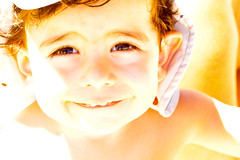 A sunny face (renata_souza_e_souza) Tags: old light boy 2 summer two portrait sun cute smile up look yellow 50mm eyes nikon child close lashes year sunny kaleo nikkor gaze hapiness d90
