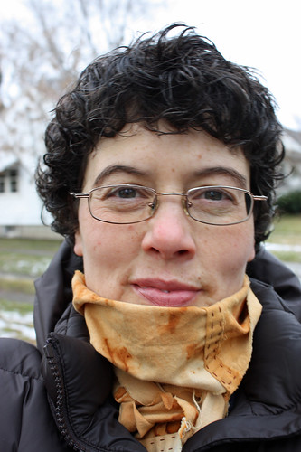 Self-portrait close-up with rust scarf