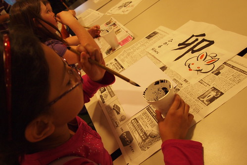 Girl enjoying making Japanese calligraphy