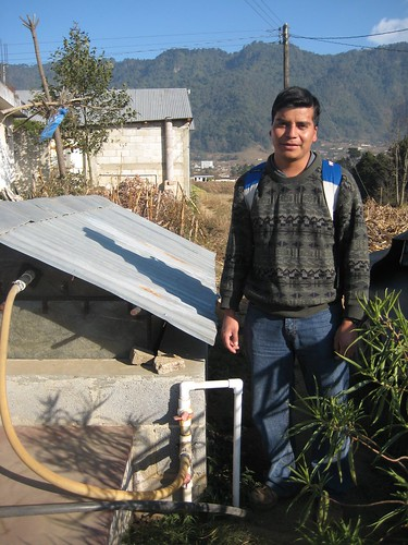 Jose next to the biodigester