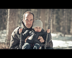 We two on the swing (.fulvio) Tags: family portrait italy baby snow me hat self canon child outdoor son swing cinematic did gi gettyimages cesane fulvio montefeltro 3rdyear ef135f2lusm 5dmarkii gismaster wwwdofphotocom familygetty2010 gettyimagesportraits familygetty2011 gettyimagesitalyq1