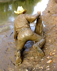 26 WS Thinking about play'n in muddy jeans jacket (Wrangswet) Tags: men wet river spurs cowboy mud boots hike jeans muddy wallowing wetlook wadding swimmingfullyclothed muddycowboy wetcowboy swimminginjeans mudwallow wetwranglerjeans bootshikingriver wetwetlookhike