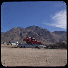 oops (Maureen Bond) Tags: ca cloud mountains cars desert kodak bluesky dirt crushing junkyard recycling salvage stacked jumped raodtrip ttv duaflexiii throughtheviewfinder maureenbond