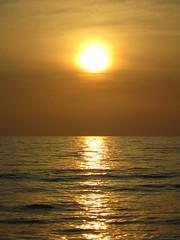 Serenity (Keith Mac Uidhir  (Thanks for 3.5m views)) Tags: ocean light sunset sea orange cloud brown sun sunlight mist reflection water sunshine yellow bronze asian thailand atardecer coast amber haze zonsondergang asia tramonto sonnenuntergang horizon sunny tailandia thalande prdosol lan thai phuket straits  strait melaka malacca coucherdesoleil nga khao lak andaman zachd soca puestadelsol phangnga tailndia gnbatm     phang thi    mueang  thajsko tajlandia matahariterbenam honghn   paglubogngaraw thaifld      taland