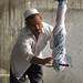 Uyghur man twisting silk to remove excess water - Hotan
