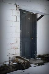 The doors. (Nessie Photography) Tags: door urban white snow black brick awning concrete tin nikon colorado decay grunge denver drain cinderblock vignette arvada d3100