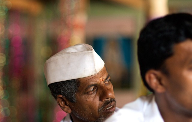Indian Man Listens at Village Meeting