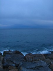Dark Dusk (cometowhereimfrom2000) Tags: sea white colour water clouds rocks dusk sanremo bluedark italy2011