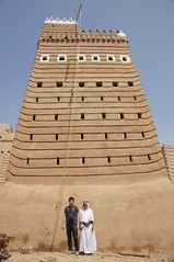 Ahmed and Mohammed in front of a being-restored 500 year old mud house (CharlesFred) Tags: architecture mohammed saudi ahmed saudiarabia mudhouse aseer 500years asir najran   saudiheritage oldmudhouse arabiasaudite oldsaudi oldsaudiarchitecture nejran