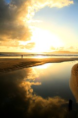 running between heaven and hell (guiceccatto) Tags: ocean sky sol beach water rio clouds mar do running correndo nascer