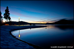 Big Bear Lake: Golden Hour (Wade Explorer) Tags: travel mountain lake snow reflection sunrise landscape mirror golden angle wide hour bigbear d90 5photosaday flickraward flickristasindios theexpeditinercom