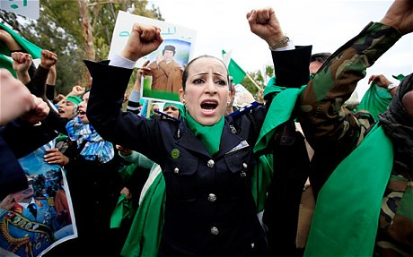 Libyans demonstrating against western imperialist attacks on their North African state. The U.S., France, Canada and Britain have launched a joint offensive aimed at toppling the government lead by Muammar Gaddafi. by Pan-African News Wire File Photos