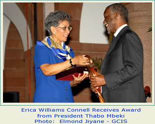 Erica Connell, the daughter of Trinidan-Tobago former Prime Minister, Dr. Eric Williams, receives an award from the former President of the Republic of South Africa, Thabo Mbeki. Connell promotes the research legacy of Williams. by Pan-African News Wire File Photos