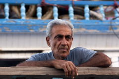 _MG_6657 (7ino) Tags: wood old blue portrait man canon boat hands paint dubai looking iran middleeast 85mm arab eyebrow iranian sailor arabian staring unitedarabemirates boatman peeled grayhair 40d dramaticlook