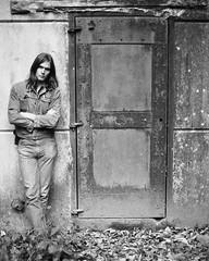 Young Man 1973 (czolacz) Tags: youngman longhair denim iron door brooding pose hudsonvalley newpaltz