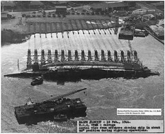 USS Utah - Salvage; Aerial view from offshore showing ship in about 90 degree position during righting operations (The U.S. National Archives) Tags: bw hawaii ship oahu wwii worldwarii pearlharbor pto battleship february salvage usnavy usn warship secondworldwar worldwartwo february10 unitedstatesnavy pacifictheatre trainingship pacifictheater ussutah bb31 pacifictheaterofoperations february101944 ag16 usnationalarchives ussutahmemorial pacifictheatreofoperations floridaclass ussutahbb31 ussutahag16 todaysdocument nara:arcid=296983 02101944