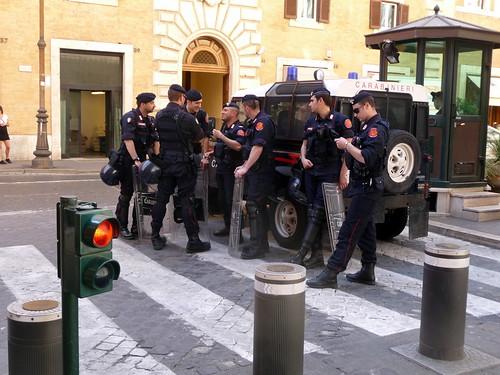 Carabinieri in a huddle, Rome, Italy