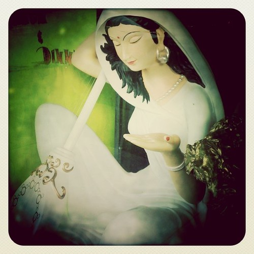 Lady in white with her sitar