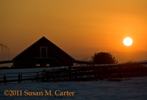 sunset behind a barn