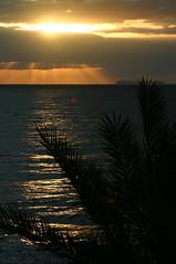 Madeira Sunrise (Andrew_Simpson) Tags: light sky cloud santacruz sun reflection portugal water clouds sunrise reflections island lights lowlight atlantic resort sunrays madeira atlanticocean madeiraportugal santacruzmadeira