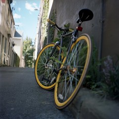 you'll be under my wheels (taovdg) Tags: color colour 120 6x6 tlr film bike bicycle yellow square lens cycling reflex dof kodak bokeh twin mat cycle 124g singlespeed medium format fixie shallow rims portra yashica 400vc