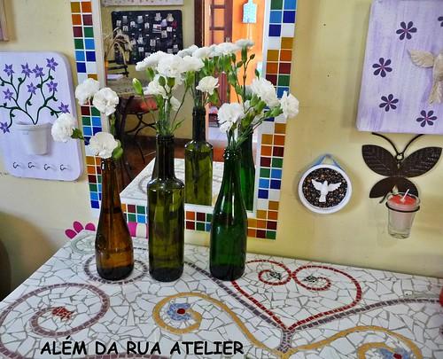 Reciclagem - flores em garrafas de vidro