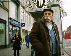 He is the walrus (deepstoat) Tags: street white london zeiss 35mm hair candid moustache holloway walrus impressive contaxt3 silverfox tash kodak800