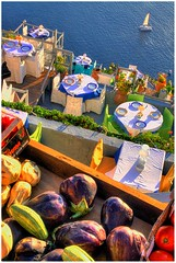 Restaurant in Santorini - Greece (Christophe Paquignon) Tags: travel color colors vegetables canon photography eos restaurant see photo nice foto view photos couleurs eggplant colorfull picture santorini greece sit tables 1750 christophe tamron backpacker grce couleur fira 50d kryyslee christophepaquignon paquignon
