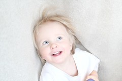 High Key - First (intentional) Attempt (Alliat) Tags: portrait baby playing smile carpet happy daylight child play blueeyes glad highkey hrafnkell windowlight
