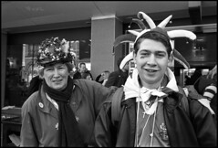 The Jester and his Mum (*monz*) Tags: street leica portrait blackandwhite bw streets film hat st zeiss 35mm birmingham day jester paddy kodak iso400 clown trix rangefinder parade 150 carl joker cz patricks facepaint clover rodinal m6 brum 20c buffoon digbeth biogon f20 monz 13m