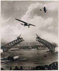 Sydney Harbour Bridge during construction, 1930, with two aeroplanes, Charles Ulm's