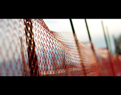 bokeh fence (marianna.armata) Tags: leica blue winter light red orange canada green net fence lens interestingness interesting shiny waves pattern quebec bokeh montreal perspective panasonic plastic explore summicron seethrough posts marianna snowfence f20 armata explored lumixg1 mariannaarmata