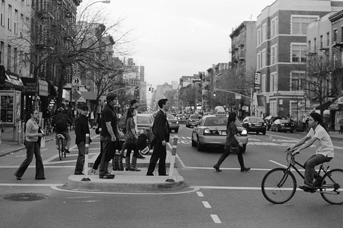 People at a busy East Village crosswalk