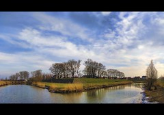 a view at the fortress (Wim Koopman) Tags: trees sky holland reed water netherlands dutch clouds canon photography canal photo stock nederland powershot system ramparts fortification fortress defence stockphoto nieuwpoort s90 stockphotography s100 wpk s95