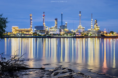 Oil refinery along the river. (nattapan.suwansukho) Tags: green chemistry automotive tower economy lighting diesel power pollution peace pipeline engineering carbon built night stack smokestack refinery ecology steam chemical supply distillation tube technology dark protection energy chimney gas industrial color production plant petroleum petrochemical smoke factory distillery industry oil environment petrol construction auto manufacture metal landscape cityscape