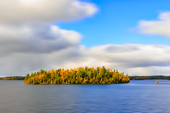 Vibrant Island (.:: Nelepl ::.) Tags: autumn canada provincial park lake water travel island clouds tourism fall foliage long exposure outdoors hiking moving manitoba canadian shield whiteshell west hawk hunt trail