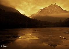 Ray of light (Dora Joey) Tags: light sunset mountain lake alps ice landscape lago mirror tramonto ray e alpi paesaggi montagna luce belluno reflextion specchio ghiaccio riflesso veneto raggio vedana bestcapturesaoi