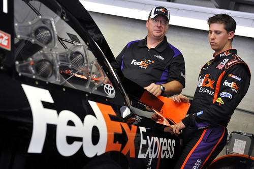 Denny Hamlin and Mike Ford talk strategy at the 2010 Brickyard 400