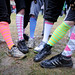 Runners found fun ways to keep their feet warm during the cold, wet race.