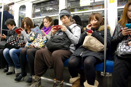 Texting on the train by scottgunn, on Flickr