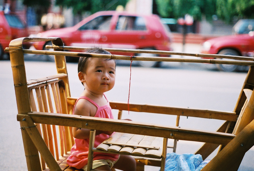Toddler in a Bamboo Stroller