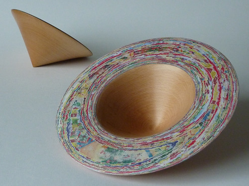 wood and compressed paper bowls made of discarded Christmas wrapping paper