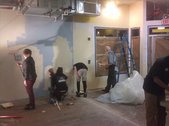 Volunteers paint the shop