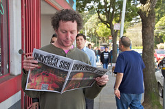 Reading Radiohead's newspaper, The Universal Sigh, at Amoeba San Francisco (Steve Rhodes) Tags: sanfrancisco california city music newspaper nikon unitedstates radiohead amoeba amoebamusic 2011 march2011 d7000 amoebasanfrancisco nikond7000 theuniversalsigh radioheadnewspaper