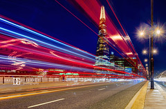 """Night Pulse"", The Shard, London, UK (davidgutierrez.co.uk) Tags: londonphotographer london photographer photography davidgutierrezphotography city art architecture nikond810 nikon urban travel color skyscraper night uk lighttrails streaminglights bluehour twilight traffic street lights longexposure colors colour colours colourful vibrant england unitedkingdom  londyn    londres londra europe beautiful cityscape davidgutierrez capital structure britain greatbritain ultrawideangle afsnikkor1424mmf28ged 1424mm d810 arts landmark attraction historic reflection iconic icon touristattraction riverthames southwark theshard shardofglass shardlondonbridge"
