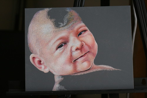 In progress colored pencil drawing of an infant, entitled Alexandra