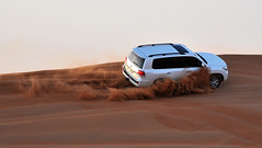 Land Cruiser (DodogoeSLR) Tags: road sunset white truck climb back sand nikon dubai power desert wind zoom seat uae middleeast 85mm off safari toyota dust nikkor suv landcruiser unitedarabemirates drift 16mmf35