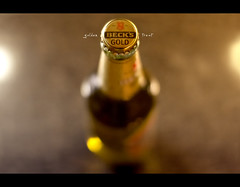 Day 180 - golden treat (Daniel | rapturedmind.com) Tags: light beer 50mm gold golden warm beers bokeh bier becks highiso day180 becksgold project365 365days 180365 365tage sigma50mmf14exdghsm goldentreat