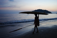 Indian man balancing surfboard on head (amazing_tina) Tags: sunset sea india water sand lifeguard flipflops indians purplesky sandtrails palolembeach indianman goabeach pastelsunset dusksetting balancingsurfboard balancinghead