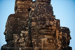 The enigmatic faces of Bayon temple at Angkor Wat (Alex Treadway) Tags: old city colour history tourism smile statue stone architecture mouth outdoors temple photography eyes ancient asia cambodia day looking faces ruin culture buddhism landmark angkorwat carving historic heads mysterious blocks staring eastern gazing enigmatic bayon imagining traveldestinations placeofinterest builtstructure